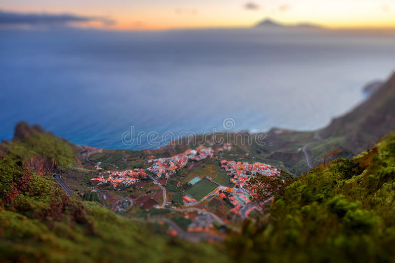 Top view on Agulo coastal village in Spain. Top view from Mirador de Abrante on Agulo coastal village with Tenerife island on background on La Gomera island on stock photo