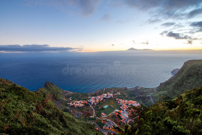 Top view on Agulo coastal village in Spain. Top view from Mirador de Abrante on Agulo coastal village with Tenerife island on background on La Gomera island on stock photos