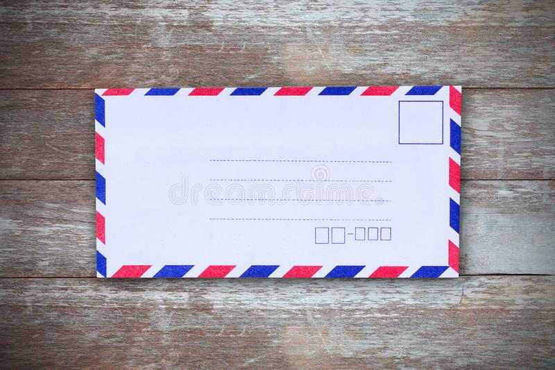 Top view with air mail envelope on the wood table royalty free stock photos