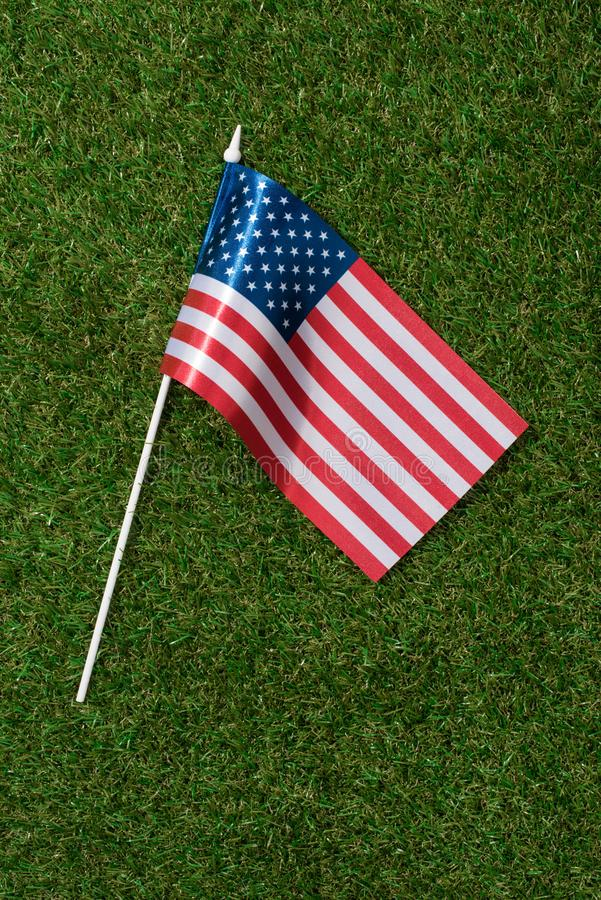 Top view of american flagpole on green grass, americas independence. Day concept stock images