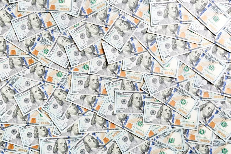 Top view of American money background. Pile of dollar cash. Paper banknotes concept.  royalty free stock photos