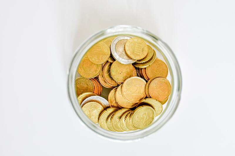 Top view amount euro coins in different price in trasparent bottle on white background. Buisiness and finance conept. Selective. Focus, flat lay stock images