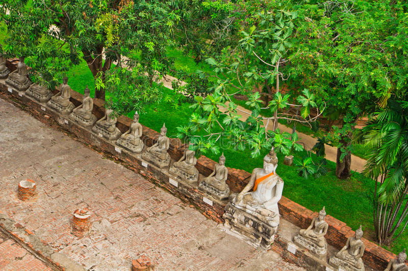 Top view of ancient buddha statue in a row stock images