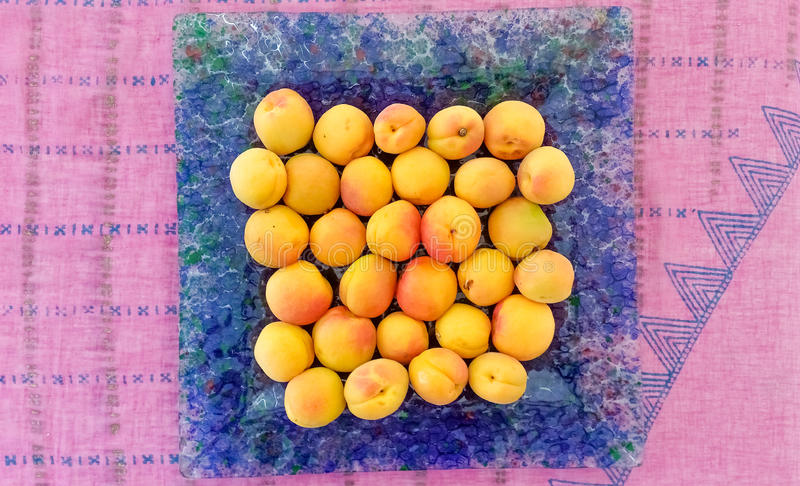 Top View of Apricots. Served in a Blue Plate royalty free stock photography
