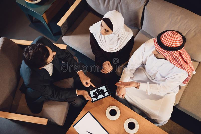 Top view. Arab couple at reception of therapist. Top view. Arab couple at reception of family therapist undergoes Rorschach test. Rorschach test concept royalty free stock photos