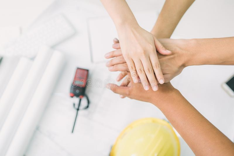Top view of architect and engineer join hand together stock photo