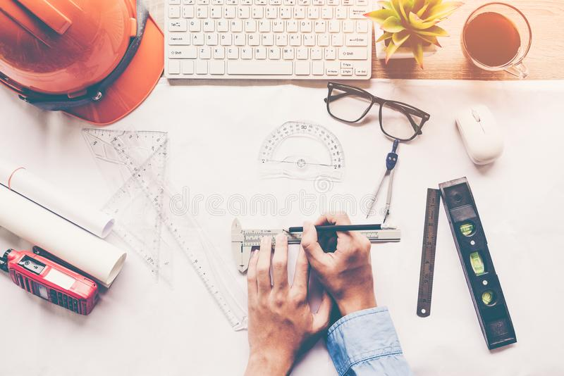Top View Architect working on blueprint. Architects workplace. Engineer tools and safety control, blueprints, ruler, orange helm. Et,radio,laptop and divider stock image