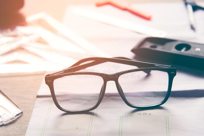 Top view architect working on blueprint with back glasses. Architects workplace. stock images
