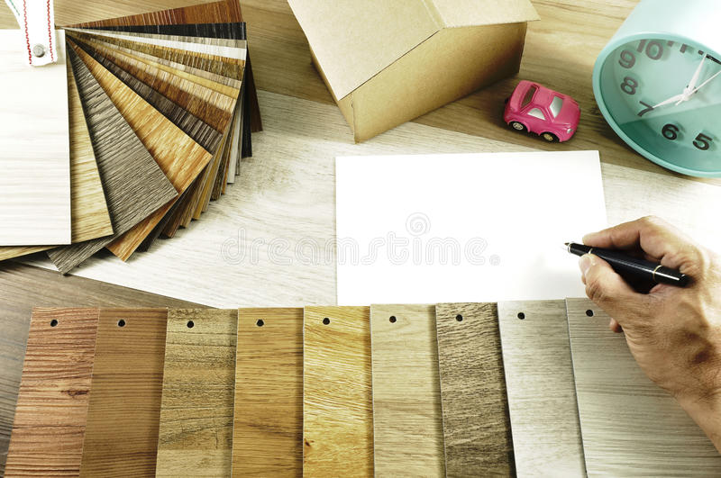 Top view of Architects & Interior designers hands design to choosing wood floor materialswood texture floor :oak tile, maple tile royalty free stock images