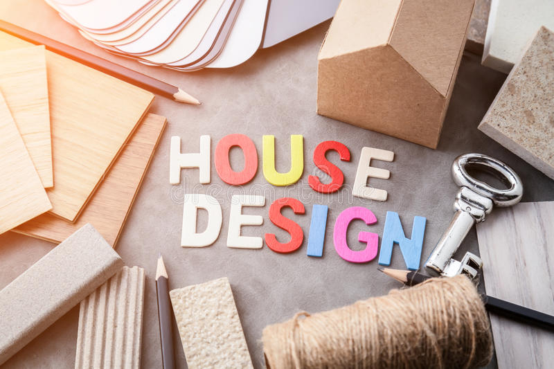Top view of architects table with stuff of modern house with mat. Erial sample on creative desk with free copyspace stock photo