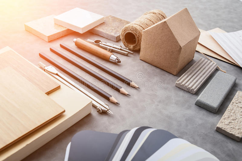 Top view of architects table with stuff of modern house with mat. Erial sample on creative desk with free copyspace royalty free stock photos