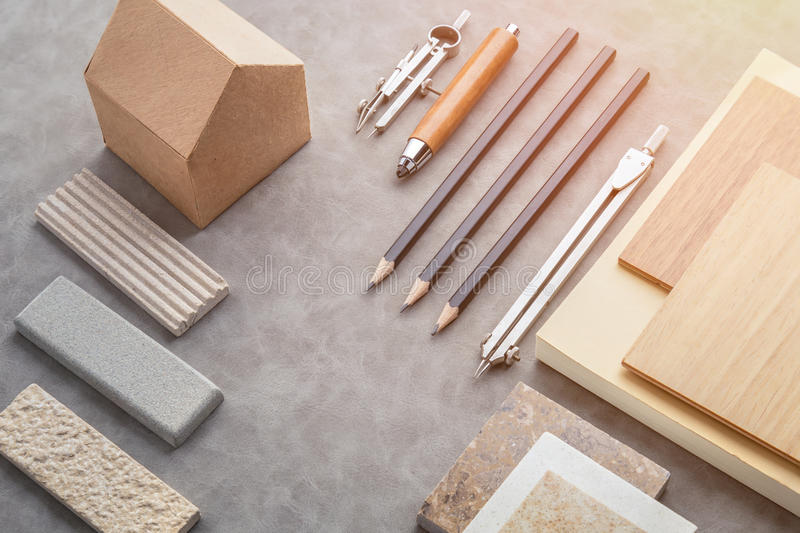 Top view of architects table with stuff of modern house with mat. Erial sample on creative desk with free copyspace stock photos
