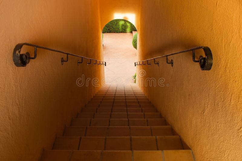 Top view architecture of concrete staircase with steel handrail inside of building. Selective focus stock photo
