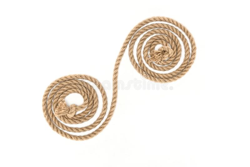 top view of arranged brown marine rope with knots stock photography