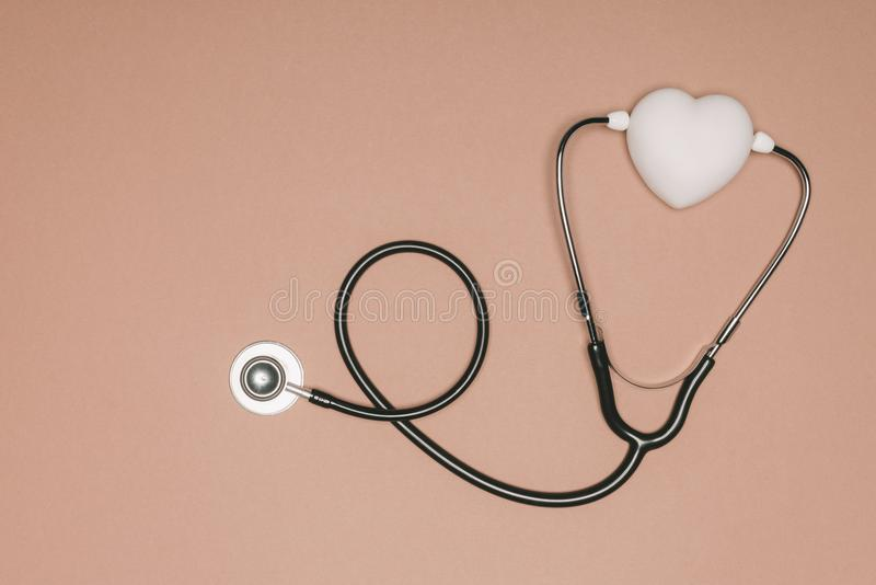 top view of arranged heart and stethoscope on beige surface, world health day concept royalty free stock photos