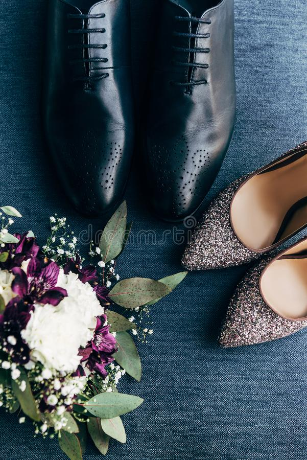 top view of arranged wedding bouquet, bridal and grooms shoes royalty free stock photos