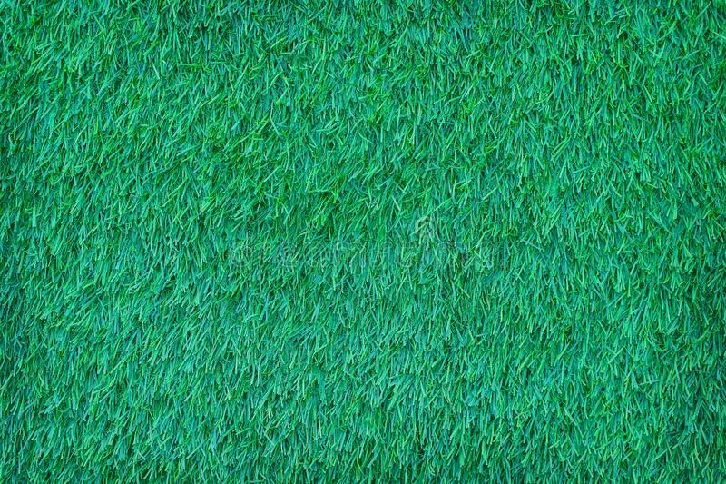 Top view artificial green grass patterns texture abstract for background stock photo