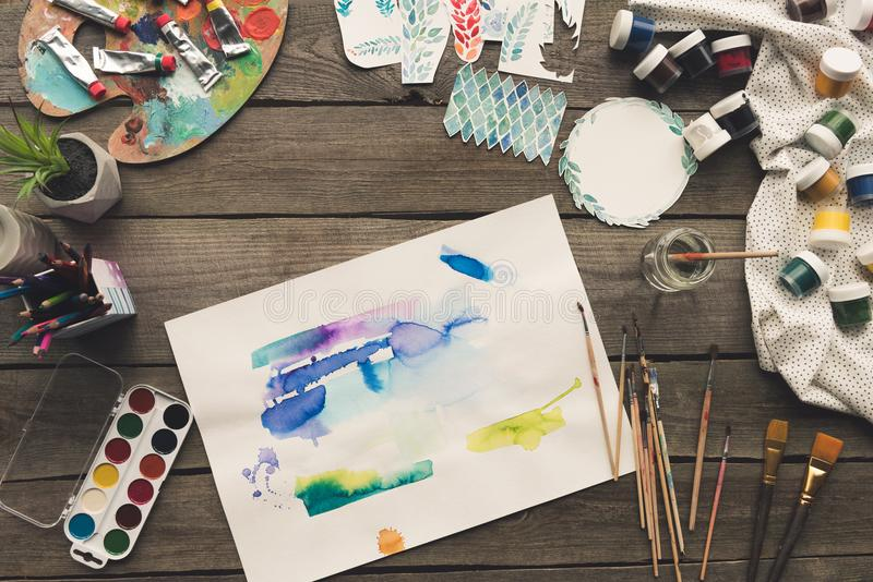 Top view of artist sketches drawn with watercolor paints and brushes. On a table royalty free stock images