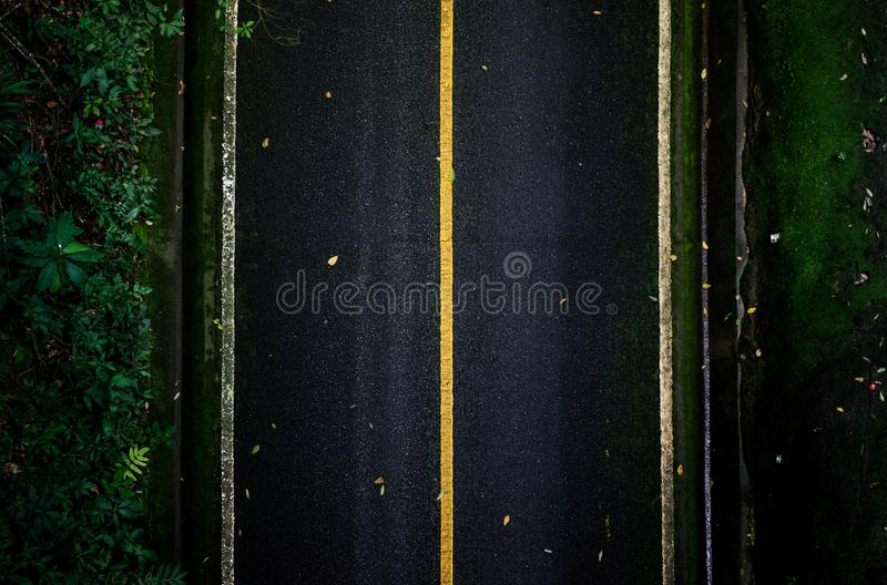 Top view of asphalt texture background. Empty road from top view. Asphalt road texture,yellow and white line on road Street Old Way Green royalty free stock photos