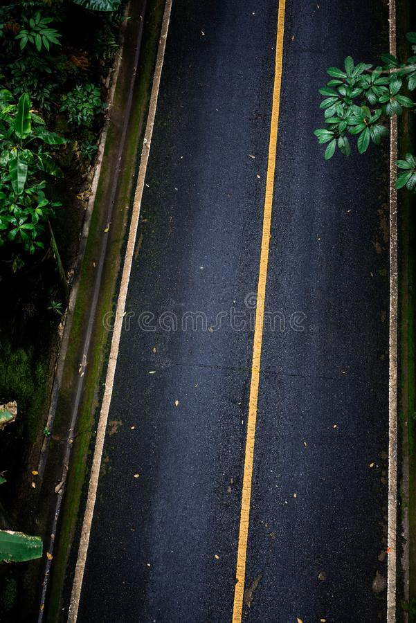 Top view of asphalt texture background. Empty road from top view. Asphalt road texture,yellow and white line on road Street Old Way Green stock photography