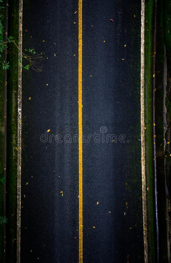 Top view of asphalt texture background. Empty road from top view. Asphalt road texture,yellow and white line on road Street Old Way Green royalty free stock photo