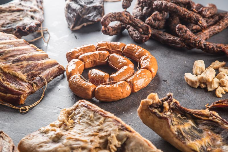 Top of view assortment of smoked pork meat products. Top of view assortment of smoked pork meat products - sausages bacon ribs etc stock images