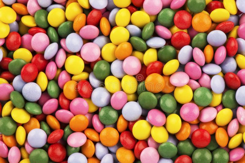 Top view on background texture of colorful hard candies. Copy space for your text royalty free stock photo