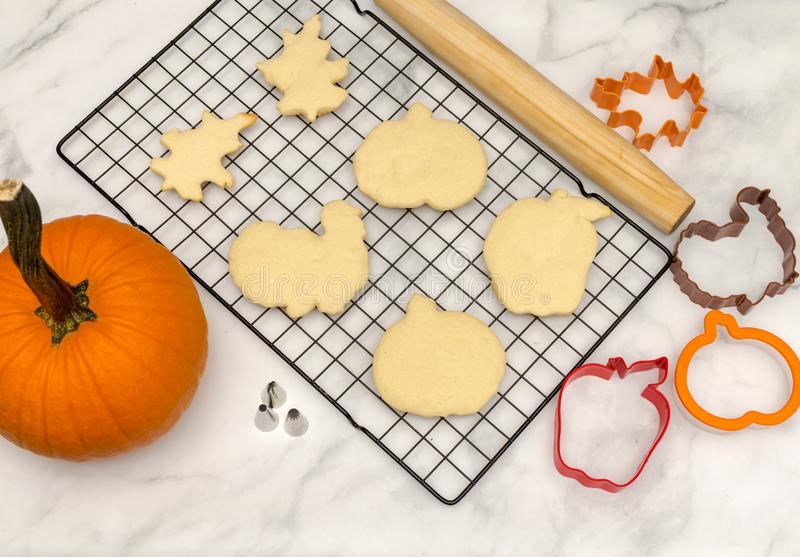 Top view baking for fall celebrations. Holiday cookies background with cutters and rolling pins stock photo