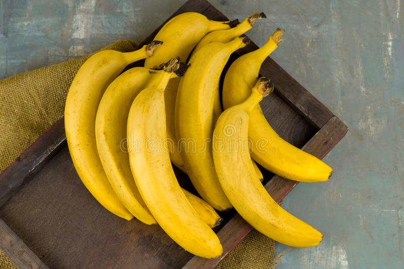 banana bunch on wooden tray on a table stock photography