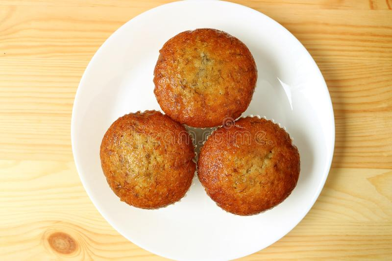 Top View of Banana Muffins on White Plate Served on Wooden Table stock image