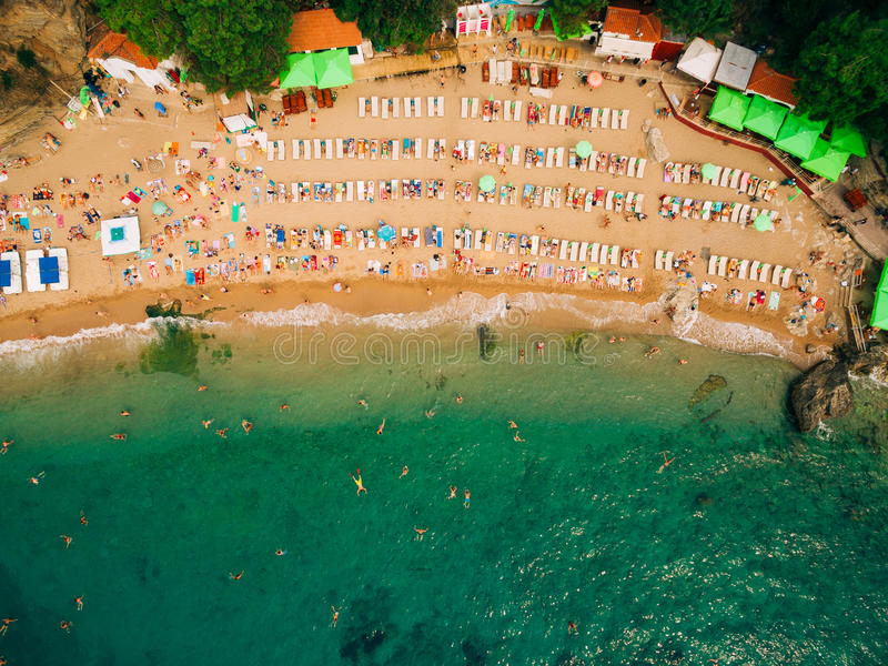 Top View of Beach. Aerial view of sandy beach with tourists swim stock photography