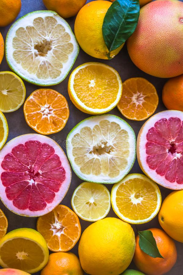Top view of beautiful display of fresh variety of citrus fruits half cut stock photos