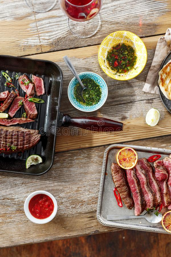Top view beef steak grill chicken steak grill wooden table sauce stock photos