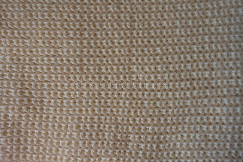 Top view of beige knitted fabric royalty free stock photography