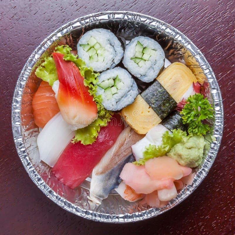 Top view of bento aluminum box, mixed nigiri and assorted sushi royalty free stock photo