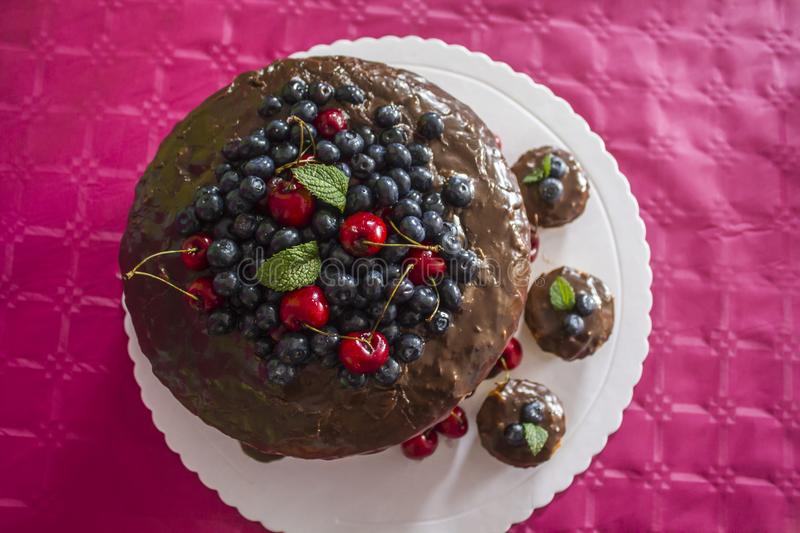 Top view of birthday cake with red fruits royalty free stock images
