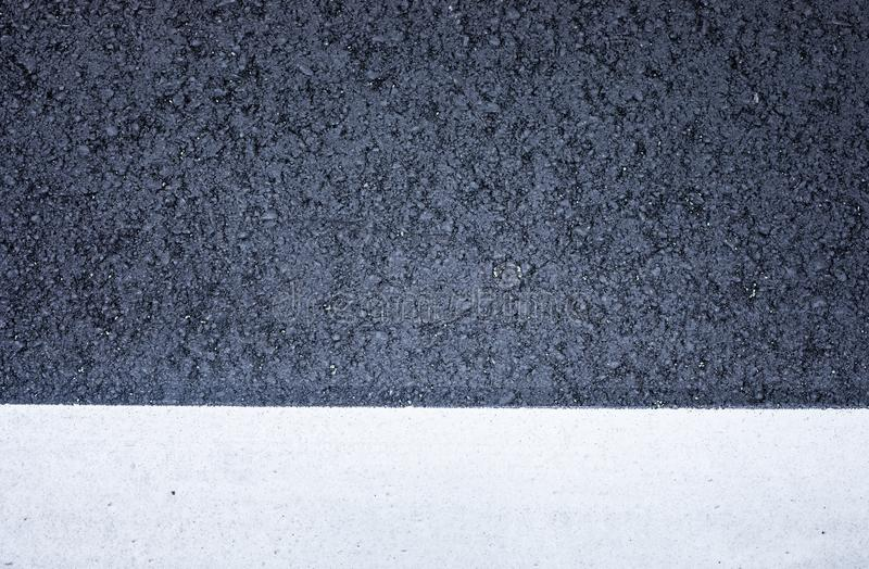 Top view of black asphalt road texture with white color line royalty free stock photo
