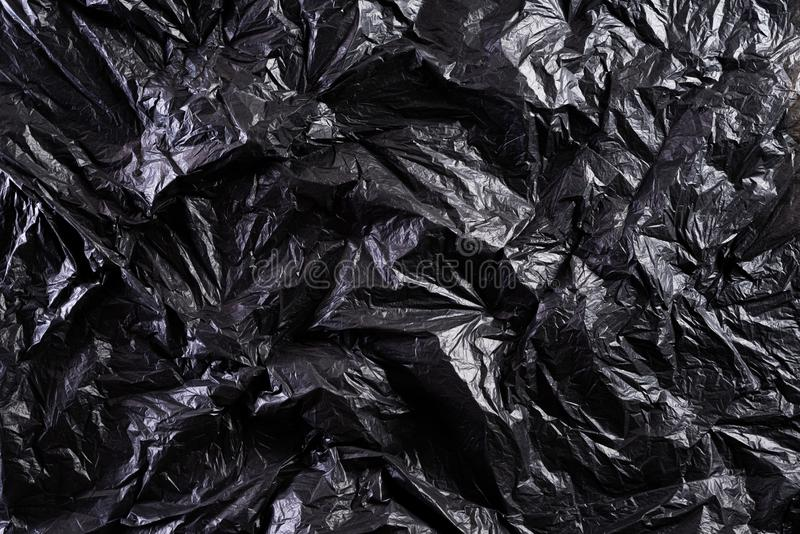 Top view of Black plastic bag texture and background. Reduction of plastic bags for natural treatment. Recycle and World stock image