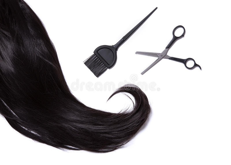 Top view on black shiny hair, hair dye brush, and professional s royalty free stock images