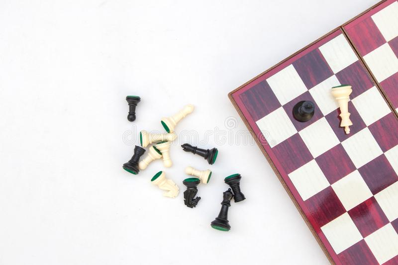 Top view Black and White chess pieces lie on chess board. stock images