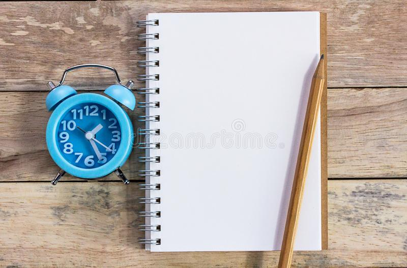 Top view with blank empty notepad, alarm clock and pencil on woo royalty free stock photo