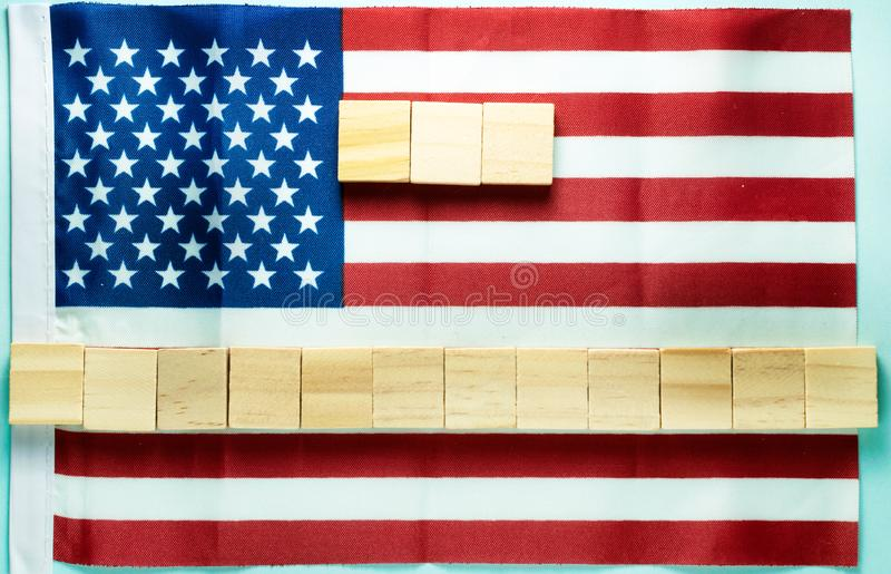 blank for inscription on fifteen wooden cubes laid out on American flag royalty free stock photos
