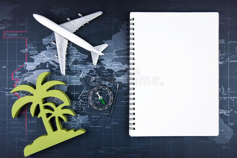 Top view of Blank notebook white paper and passenger plane on world map background with copy space for your. Message.Business travel transportation system royalty free stock photography