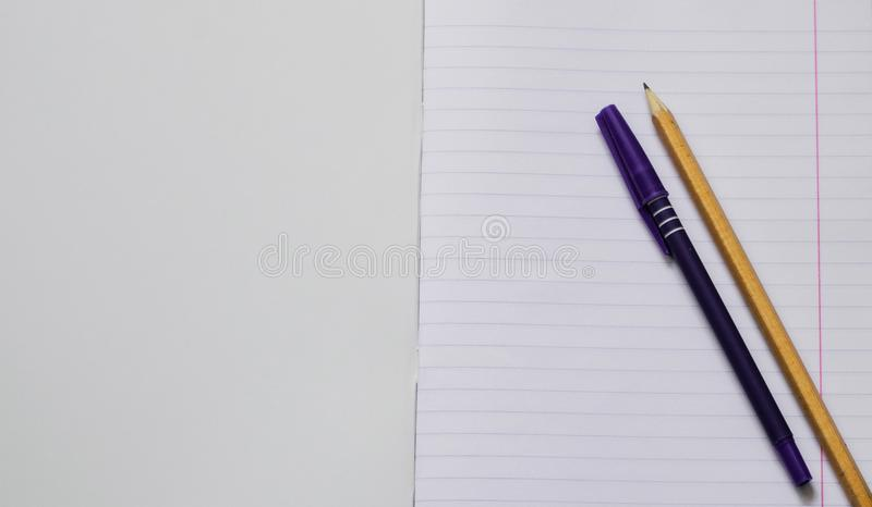 Top view of blank paper with pencil and pen. Pencil and pen on a notebook sheet. Space for text. stock images