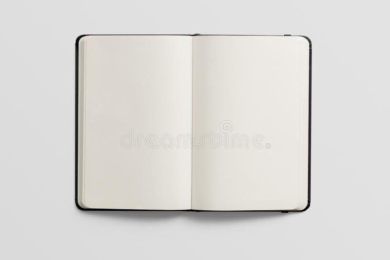 Top view of Blank photorealistic notebook mockup on light grey background. stock photography