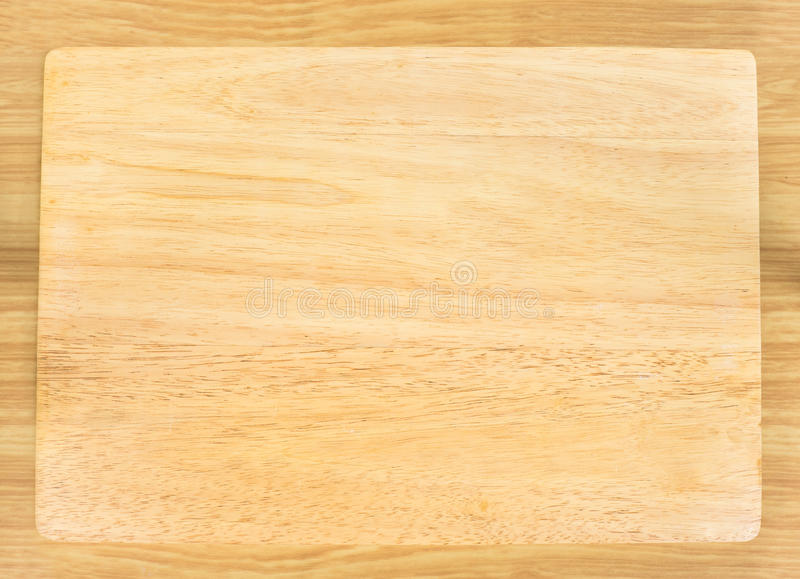 Top view of Blank wooden plate on table top,Mock up for adding y stock photography
