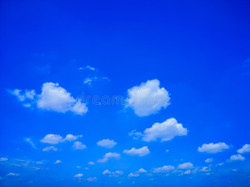 Top view blue sky white cloud beautiful day full frame background. Top view blue sky and white cloud beautiful day full frame background.Deep blue sky royalty free stock photo