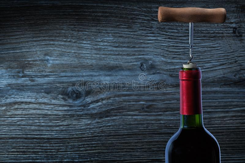 Top view on bottle of red wine and corckscrew royalty free stock image