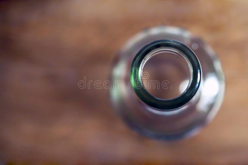 Top View Of A Bottleneck, Empty Bottle On A Wooden Table. Healthy Living And Detox Concept. Abstinence, Alcoholism Treatment. New Year's Resolutions stock photography
