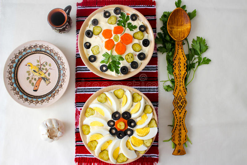 Top view of bowls of salad with mayonnaise, vegetables and eggs, Russian Olivier salad or Romanian Boeuf salad royalty free stock photography